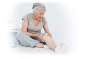 older woman checking legs for leg veins